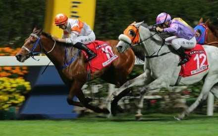Lyle Hewitson salutes aboard Kiram at Happy Valley on Wednesday night. Photos: Kenneth Chan