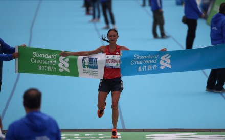 Volha Mazuronak (centre) of Belarus wins the women's Standard Chartered Hong Kong Marathon in 2019. Photo: Nora Tam