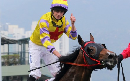 Ryan Moore gives a thumbs up after winning the Hong Kong Derby on Ping Hai Star in 2018. Photos: Kenneth Chan