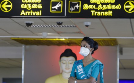 A worker at Bandaranaike International Airport in Colombo, Sri Lanka, wears a cloth mask to protect herself against the coronavirus on Friday. Photo: EPA-EFE