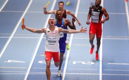 Jakub Krzewina of Poland celebrates winning the men's 4x400 metres relay at the IAAF World Indoor Championships in 2018. Photo: Reuters
