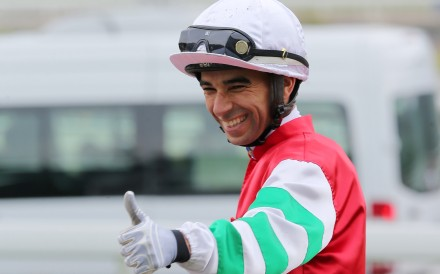 An elated Joao Moreira celebrates Seize The Spirit's win. Photo: Kenneth Chan