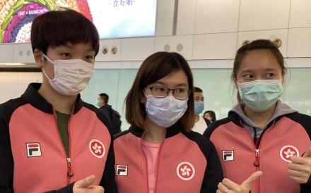 Hong Kong women's table tennis players wear masks on their return from Portugal. From left: Doo Hoi-kem, Lee Ho-ching, Minnie Soo Wai-yam. Photo: Chan Kin-wa