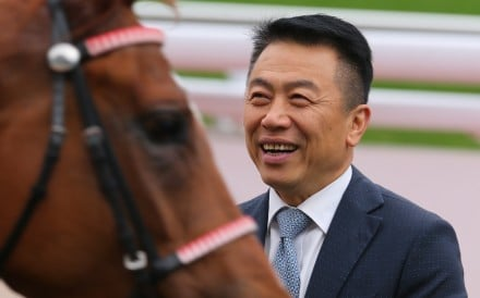 Ricky Yiu is all smiles after Voyage Warrior's win on New Year's Day. Photos: Kenneth Chan