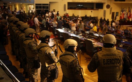 Soldiers armed with automatic weapons briefly occupied El Salvador's Congress. Photo: Reuters