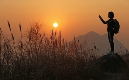A hiker enjoys the view at Sunset Peak, Hong Kong. Exercising outdoors helps to reduce anxiety and depression. Photo: Felix Wong