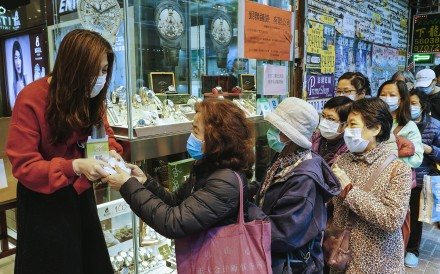 Elderly people queue up for free face masks distributed by a watch and jewellery shop at Percival Street in Causeway Bay on February 10. As Hong Kong struggles to contain the spread of the coronavirus, solidarity will go a long way. Photo: Robert Ng