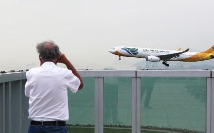 A Cebu Pacific Air passenger plane lands at Hong Kong International Airport. Photo: Handout