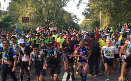 Hundreds of runners take on the Oxfam Trailwalker 2019, despite it being cancelled due to the ongoing protests, marking the first of many unofficial races. Photo: Mark Agnew