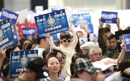 A child holds a placard at a pro-police rally outside the Legislative Council building in Hong Kong in November 2019. Photo: Ye Aung Thu/AFP