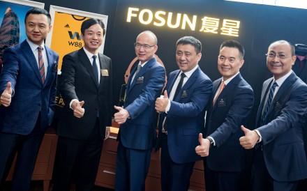 Fosun's key management (from left) Xu Xiaoliang, Wang Qunbin, Guo Guangchang, Chen Qiyu, Robin Wang and Gong Ping pose for a photo after a briefing in Hong Kong in August 2018. Photo: Bloomberg