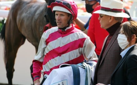 Hugh Bowman and John Moore talk after the run of Enjoying in the Classic Cup. Photos: Kenneth Chan