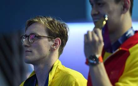 Silver medallist Australia's Mack Horton (left) and gold medallist Sun Yang pose with their medals after the final of the men's 400m freestyle event at the 2019 world championships. Photo: AFP