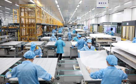 Employees on a photovoltaic solar panel assembly line at Risen Energy in Ningbo in Zhejiang province on February 21, 2019. Zhejiang Daily via Reuters