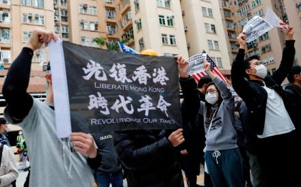 Residents wear masks as they march against the government's plan to set up a quarantine site close to their community amid the coronavirus outbreak in Hong Kong. Photo: Reuters
