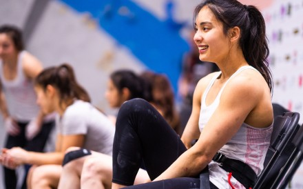 Alannah Yip takes a rest before her climb at the Pan-American Continental Championships in Los Angeles last month. Photo: International Federation of Sports Climbing