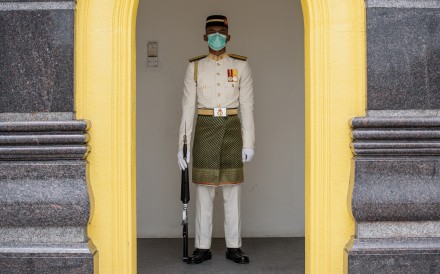 A Royal Malay Regiment Guard of Honour wears a protective face mask in Kuala Lumpur. Photo: AFP