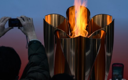 The Tokyo 2020 Olympic flame is displayed outside the Sendai railway station, Miyagi prefecture. Photo: AFP