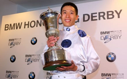 Vincent Ho poses with the Hong Kong Derby trophy. Photos: Kenneth Chan