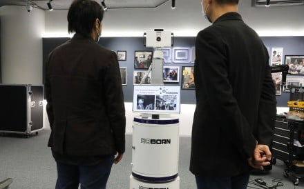 5G-enabled mobile robot scanning people's body temperature. Photo: K. Y. Cheng