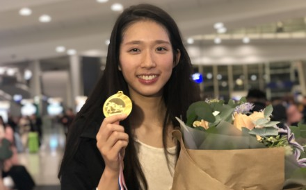 Fencer Vivian Kong Man-wai shows off the gold medal she won at a World Cup event in Havana, Cuba in 2019. Photo: Chan Kin-wa