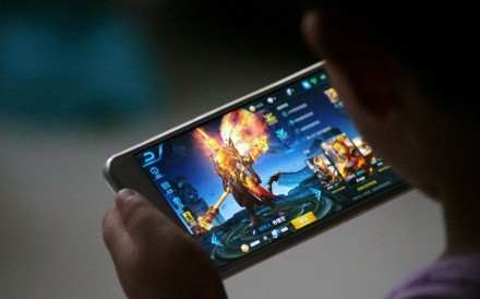 A child plays Tencent's game Honour of Kings which led the charts with daily active users surpassing 100 million over the Lunar New Year holiday. Photo: Reuters