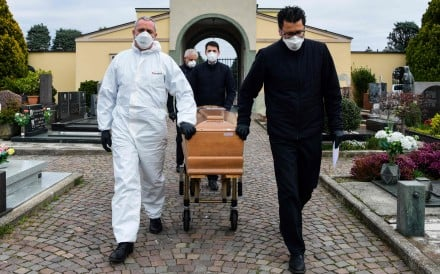 With relatives of the deceased in quarantine, there are only pallbearers at this cemetery in Italy's Lombardy region. Photo: AFP