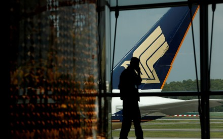A Singapore Airlines plane sits on the tarmac at Singapore's Changi Airport March 11, 2020. Photo: Reuters
