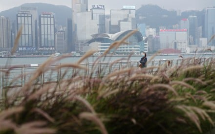 A lone woman walks along the Tsim Sha Tsui promenade on March 19, as most Hongkongers stay away from public spaces due to the rising number of Covid-19 cases in the city. Photo: Sam Tsang