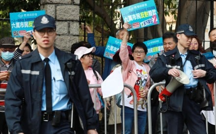 Members of a concern group demonstrate in support of the police outside RTHK's headquarters in Kowloon Tong on January 18. Photo: May Tse