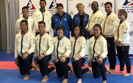 Karate coach Rida Bel-Lahsen (second from left, back row) with the squad for the 2018 Asian Games. He has become the forth member of the karate team to test positive for coronavirus. Photo: Chan Kin-wa