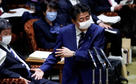 Japan's Prime Minister Shinzo Abe wears a protective cloth face mask in parliament on Wednesday. Photo: Reuters