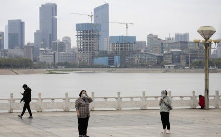 Residents observe social distancing at a park along the Yangtze River in Wuhan on Wednesday. Photo: AP