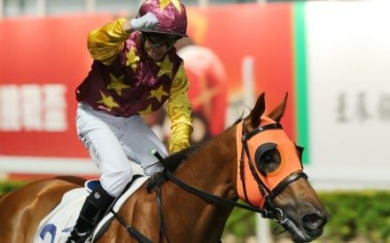 Alfred Chan pumps his first after saluting aboard Very Sweet Orange. Photos: Kenneth Chan