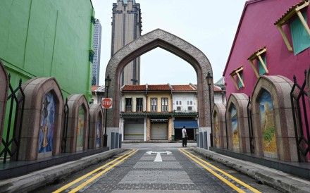 A man stands along a quiet street in Singapore on April 7 as the country ordered the closure of all businesses deemed non-essential as well as schools to combat the spread of Covid-19. Photo: AFP