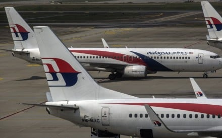 Malaysia Airlines aircraft are seen from the viewing gallery at the Kuala Lumpur International Airport. Photo: EPA-EFE
