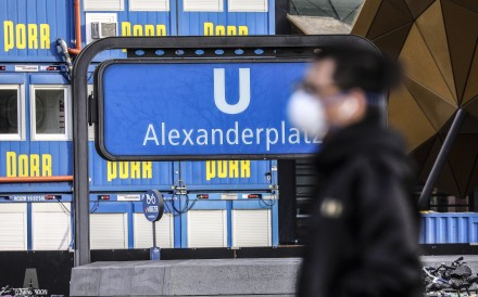 A man wearing a protective face mask passes by the railway station at Alexanderplatz in Berlin, Germany, on April 3. The German government and local authorities are increasing measures to stem the spread of the coronavirus. Photo: EPA-EFE