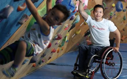 Lai Chi-wai and his son Gordon at a climbing gym in San Po Kong in Wong Tai Sin, Hong Kong. Photo: Nora Tam