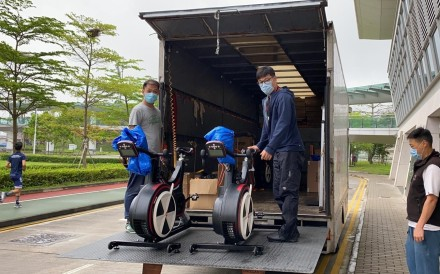 Hong Kong Sports Institute 'Ergo Panda' coaches load a truck with exercise bikes to deliver to rowers stuck at home. Photo: HKCRA
