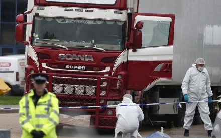 Police officers at the scene after the truck was found. Photo: AP