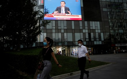Premier Li Keqiang's press conference on the final day of the National People's Congress was the first not to be conducted face-to-face with the media, with China's premier appearing via a screen in the media centre. Photo: Reuters