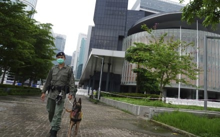 A policeman patrols with his dog outside the Legislative Council on May 26, a day ahead of a major protest organised against Beijing's planned national security law. Photo: Sam Tsang