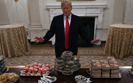 US President Donald Trump and a table full of fast food at the White House for a visiting sports team in 2019. File photo: AP