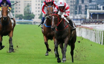 Baltic Whisper motors through the rain-soaked surface to win at Sha Tin on Sunday. Photos: Kenneth Chan