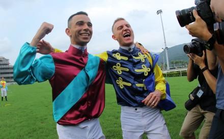 Jockeys Joao Moreira (left) and Zac Purton pose for photographers at the end of 2018-19 season. Photos: Kenneth Chan