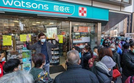 People queue outside Watsons for masks at a branch in Whampoa. Photo: Nora Tam