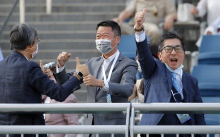 Golden Sixty's owner Stanley Chan (right) celebrates his win in the BMW Hong Kong Derby. Photos: Kenneth Chan
