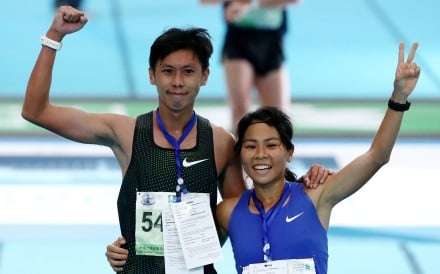 Chan Ka-ho and wife Christy Yiu celebrate at the finish of the 2019 Standard Chartered Hong Kong Marathon at Victoria Park. Chan came third in the half marathon, while Yiu won the same event in the women's category. Photo: Nora Tam