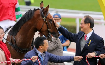 Philip Chen pats his horse Seize The Spirit after a win in February. Photo: Kenneth Chan