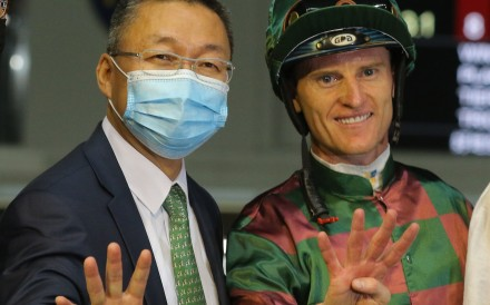 Jockey Zac Purton and trainer Francis Lui celebrate their four-timer at Happy Valley on Wednesday night. Photos: Kenneth Chan